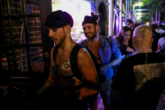 People enter the Stonewall Inn to celebrate, in the Greenwich Village neighborhood of New York June 26, 2015. (Photo by Eduardo Munoz/Reuters)