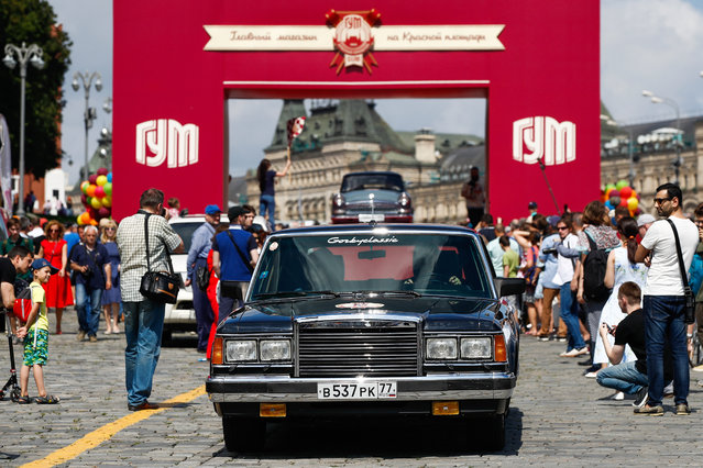 A ZIL vintage car during the 2019 GUM Motor Rally featuring classic cars in Moscow, Russia on July 28, 2019. The average age of the vehicles participating in the competition is 62. Some of them are reconstructed with care and attention to detail; some of them are treasures that have been in their respective families for generations. (Photo by Artyom Geodakyan/TASS via Getty Images)