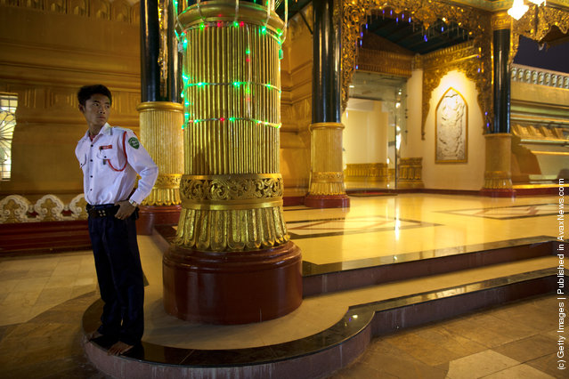 A security guard stands by the Ouparta Thandi  pagoda which was built to mirror the famous  Shwedagon pagoda