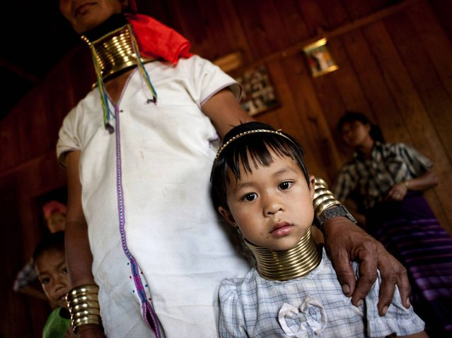 Kayan women usually start wearing six to ten rings when they are five to ten-years-old and then they put on one more ring a year for years after then. (Photo by Ye Aung Thu/AFP Photo)