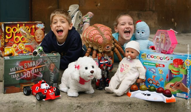 Children pose for photographs with the Dream Toys predicted Top 12 toys for Christmas during the Dream Toys 2007 Christmas predictions fair