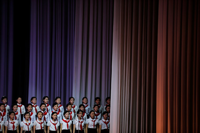 Girls are wheeled on a sliding platform to the stage at the Mangyongdae Children's Palace in Pyongyang, North Korea May 5, 2016. (Photo by Damir Sagolj/Reuters)