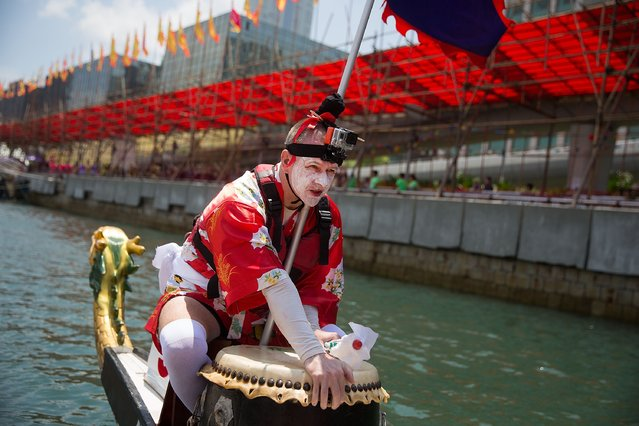 A dragon boat racer prepares for drum a rhythm for his teammates during the fancy dress race on July 5, 2015 in Hong Kong, Hong Kong. (Photo by Taylor Weidman/Getty Images for Hong Kong Images)