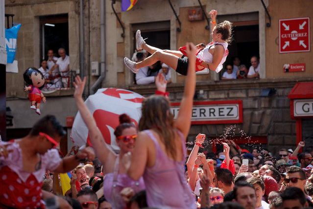 "Revellers enjoy the atmosphere during the opening day or ""Chupinazo"" of the San Fermin Running of the Bulls fiesta on July 6, 2015 in Pamplona, Spain. The annual Fiesta de San Fermin, made famous by the 1926 novel of US writer Ernest Hemmingway entitled ""The Sun Also Rises"", involves the daily running of the bulls through the historic heart of Pamplona to the bull ring. (Photo by Pablo Blazquez Dominguez/Getty Images)"
