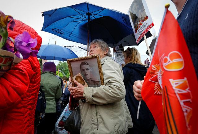 A woman holds portraits of deceased relatives who took part in World War Two during a march at Victory Day commemorations in  Almaty, Kazakhstan, May 9, 2016. (Photo by Shamil Zhumatov/Reuters)