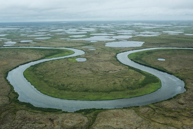 The marshy, tundra landscape surrounding Newtok is seen from a plane on July 6, 2015 outside Newtok, Alaska. Newtok, which has a population of approximately of 375 ethnically Yupik people, was established along the shores of the Ninglick River, near where the river meets the Bering Sea, by the Bureau of Indian Affairs (BIA) in 1959. (Photo by Andrew Burton/Getty Images)
