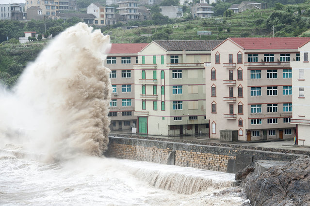 Huge waves are seen as typhoon Chan-hom comes near Wenling, east China's Zhejiang province on July 10, 2015. Typhoon Chan-hom lashed Japan's Okinawa island chain on July 10 as it pushed towards Taiwan and onto China, leaving more than 20 people injured. (Photo by AFP Photo)