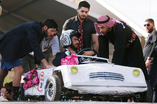 A competitor gets ready to drive his homemade vehicle without an engine during the Red Bull Soapbox Race in Amman, Jordan on September 20, 2019. (Photo by Muhammad Hamed/Reuters)