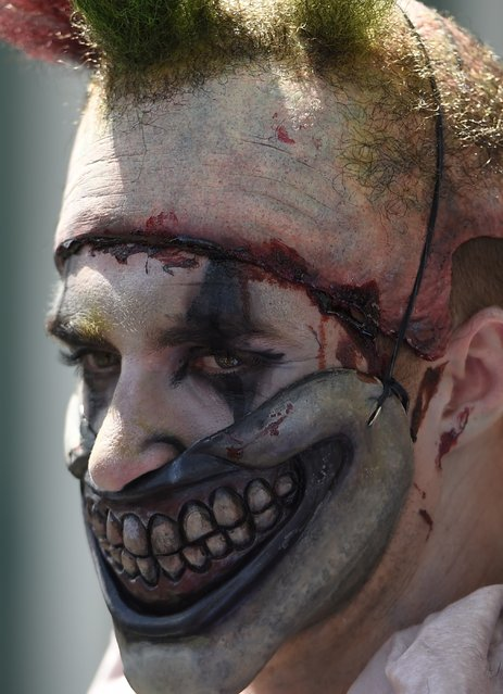 An attendee in a scary clown costume is seen on the third day of Comic Con International in San Diego, California, July 11, 2015. (Photo by Robyn Beck/AFP Photo)