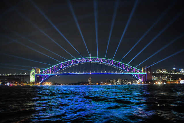 "The Harbour Bridge is lit with special lighting during the media preview of Vivid Sydney on May 23, 2019 in Sydney, Australia. ""Vivid Sydney"" runs from May 24 throughout the city and suburbs of Sydney with hundreds of illuminated buildings and exhibits which attract hundreds of thousands of visitors each year. (Photo by James D. Morgan/Getty Images)"