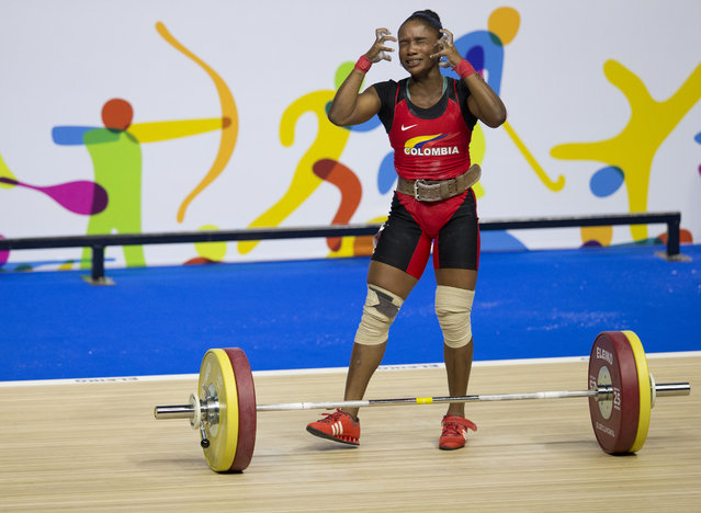 Colombia's Lina Marcela Rivas Ordonez reacts after a failed lift attempt in the women's 58kg weightlifting at the Pan Am Games in Oshawa, Ontario, Sunday, July 12, 2015. (Photo by Rebecca Blackwell/AP Photo)