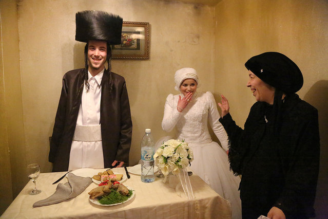 """First Time"". Mea Shearim, ultra orthodox district of Jerusalem. Newly married, Aaron and Rivkeh after the wedding ceremony are to stay together for the very first time, alone. Their marriage was arranged by families. 18 years old candidates confirmed the choice in result of the one meeting only. Since then until the wedding day they were prohibited to meet or even talk. Photo location: Mea Shearim. Jerusalem, Israel. (Photo and caption by Agnieszka Traczewska/National Geographic Photo Contest)"