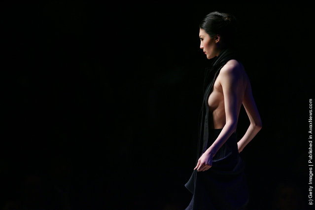 A model walks down the runway at the 13th China International Young Fashion Designers Contest during China Fashion Week
