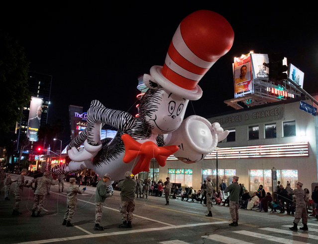 A Dr. Seuss balloon character is floated down Sunset Blvd during the 88th annual Hollywood Christmas Parade in Hollywood, California on December 1, 2019. (Photo by Mark Ralston/AFP Photo)