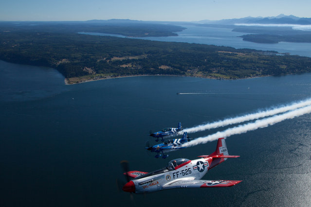 Air National Guard and the Heritage Flight Museum's P-51 Mustang takes to the skies at Seafair 2015 on Thurs., July 30, 2015 in Seattle, Wash. (Photo by Matt Mills McKnight/AP Images for John Klatt Airshows, Inc.)