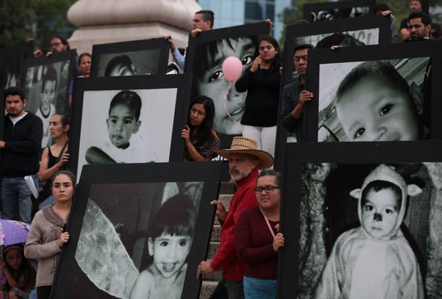 Parents and relatives of 49 children who died on 05 June 2009 in a fire at the ABC Day Care Center in Hermosillo, Sonora, march displaying big-scale photographs of their children as they ask for justice during the seventh anniversary of the tragedy, in Mexico City, Mexico, 05 June 2016. According to reports, some 200 large photographs of the babies were paraded in the march. (Photo by Mario Guzman/EPA)