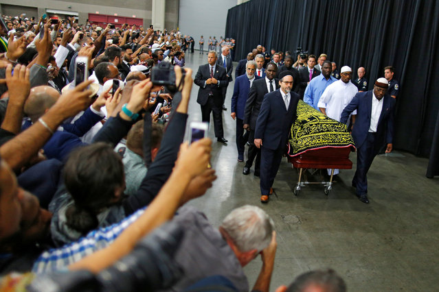 Worshipers and well-wishers take photographs as the casket with the body of the late boxing champion Muhammad Ali is brought for his jenazah, an Islamic funeral prayer, in Louisville, Kentucky, U.S. June 9, 2016. (Photo by Carlos Barria/Reuters)