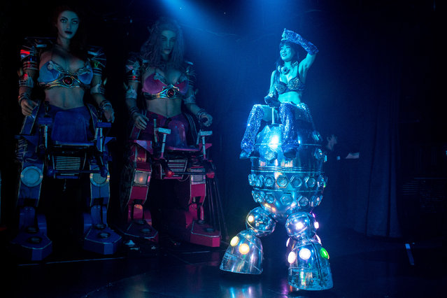 A dancer rides a robotic vehicle during a show at The Robot Restaurant on June 29, 2014 in Tokyo, Japan. The now famous Robot Restaurant opened two years ago in Kabukicho area of Shinjuku at an estimated cost of 10 million U.S. dollars. (Photo by Chris McGrath/Getty Images)