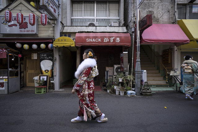 A woman wearing a kimono walks toward the Toshimaen amusement park to attend a Coming of Age ceremony on January 13, 2020 in Tokyo, Japan. Coming of Age Day is a Japanese holiday held every January to celebrate people who have reached 20, the official age of adulthood in Japan. About 1.22 million people nationwide have reached 20 years old this year according to the Ministry of Internal Affairs and Communications. (Photo by Tomohiro Ohsumi/Getty Images)