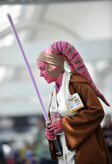 Christine Dennis talks with friends as she wears her Star Wars costume on day 1 of the 2014 Comic-Con International Convention, July 24, 2014, in San Diego. (Photo by Denis Poroy/Invision/AP Photo)