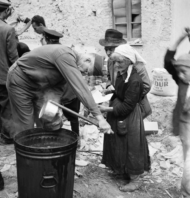 Italian refugees in Minturno receive food from the Allied Military Government kitchen, after the Allied got control of the town, May 31, 1944.  For many it was their first hot meal in weeks. (Photo by Henry L. Griffin/AP Photo)