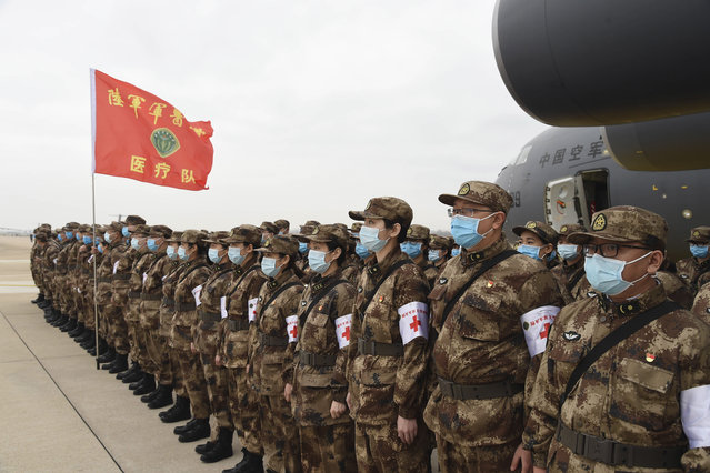 In this photo released by China's Xinhua News Agency, Chinese military medics arrive at the Tianhe International Airport in Wuhan, central China's Hubei Province, February 13, 2020. China has mobilized its military resources in its fight against the COVID-19 viral outbreak. (Photo by Li Yun/Xinhua via AP Photo)