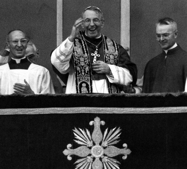 Pope John Paul I smiles and waves with both hands to crowd filling St. Peter's Square August 26, 1978 when the former patriarch of Venice appeared on the balcony of St. Peter's Basilica, short time after the white smoke coming out of the chimney of the Sistine Chapel, indicating that the conclavists had elected a successor for Pope Paul VI. (Photo by AP Photo)
