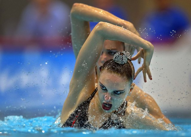 Daria Korobova and Svetlana Kolesnichenko of Russia perform during the duet synchronized swimming free routine at the LEN Swimming European Championships in Berlin, Germany, on August 14, 2014. (Photo by Michael Sohn/Associated Press)