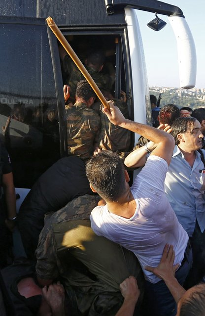 Soldiers are beaten by the mob as they board a bus after troops involved in the coup surrendered on the Bosphorus Bridge in Istanbul, Turkey July 16, 2016. (Photo by Murad Sezer/Reuters)