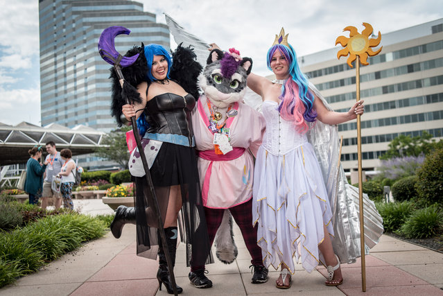 "From left: Melisse (cq) Grimm, aka ""Nightmare Moon"", of Hagerstown, Amanda Riggins, aka ""Blizzie"" of Arthurdale, WV, and Tiffany Workman, aka ""Celestia"", of Charlestown, WV, pose for a photo on the convention center patio in Baltimore, MD on July 8, 2016. (Photo by Andre Chung/The Washington Post)"