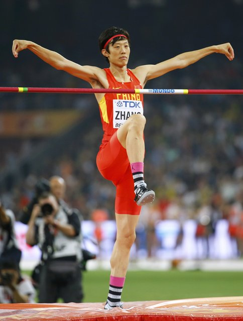Guowei Zhang of China reacts as he competes in the men's high jump final during the 15th IAAF World Championships at the National Stadium in Beijing, China August 30, 2015. (Photo by Damir Sagolj/Reuters)