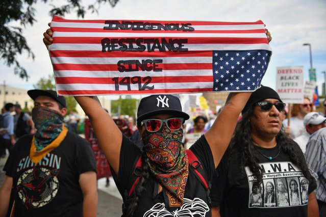 Demonstrators march through downtown ahead of the Republican National Convention, July 17, 2016, in Cleveland. (Photo by Jeff J. Mitchell/Getty Images)