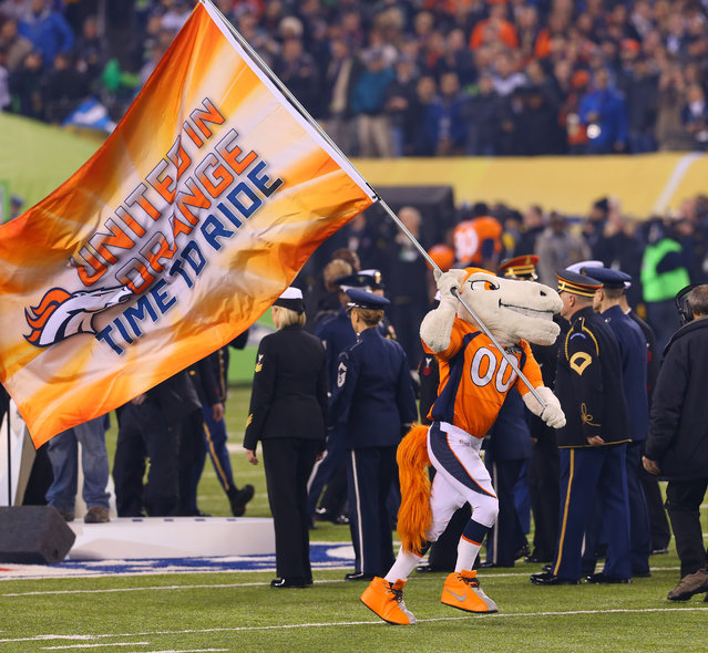 February 2, 2014; East Rutherford, NJ, USA; Denver mascot waves the Broncos colors before Super Bowl XLVIII at MetLife Stadium. (Photo by Ed Mulholland/USA TODAY Sports)