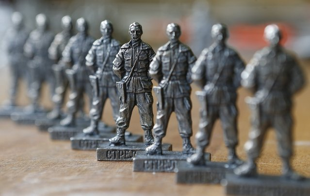 """Figurines of former pro-Russian separatist commander Igor Strelkov from the collection entitled """"Toy Soldiers of Novorossiya"""" are on display at a workshop in Moscow August 29, 2014. (Photo by Sergei Karpukhin/Reuters)"""