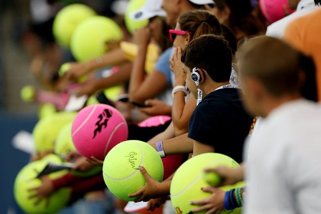 Fans wait for autographs on Day Five of the 2014 US Open at the USTA Billie Jean King National Tennis Center on August 29, 2014 in the Flushing neighborhood of the Queens borough of New York City. (Photo by Matthew Stockman/Getty Images)