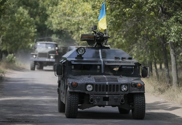 Ukrainian servicemen ride in an armoured vehicle in Kramatorsk, September 1, 2014. (Photo by Gleb Garanich/Reuters)