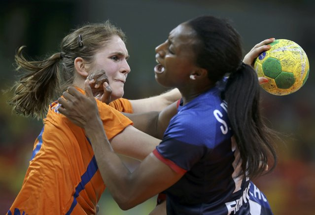 2016 Rio Olympics, Handball, Preliminary, Women's Preliminary Group B Netherlands vs France, Future Arena, Rio de Janeiro, Brazil on August 6, 2016. Laura van der Heijden (NED) of Netherlands and Siraba Dembele (FRA) of France in action. (Photo by Marko Djurica/Reuters)