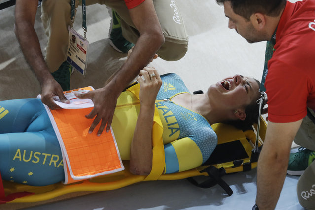 Melissa Hoskins of the Australian women's track cycling team is tended to after crashing during a training session inside the Rio Olympic Velodrome during the 2016 Olympic Games in Rio de Janeiro, Brazil, Monday, August 8, 2016. (Photo by Pavel Golovkin/AP Photo)