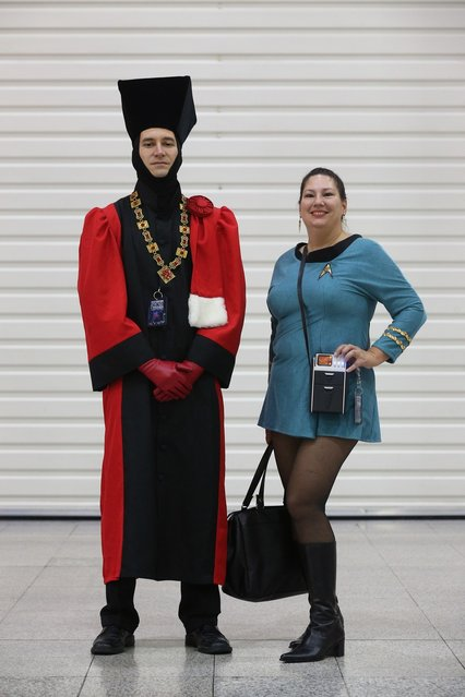 """Chris Miller (L), dressed as 'Judge Q', and Brenda Havens, dressed as a Science Officer from The Original Series, arrive to attend the """"Destination Star Trek London"""" convention at the ExCeL centre on October 19, 2012 in London, England. The three-day convention, which opened to the general public today, will be attended by all five actors who played captains throughout the 46-year-old series.   (Photo by Oli Scarff)"""