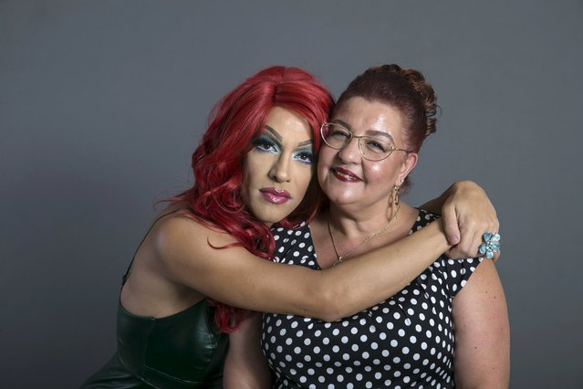 Drag queen Nisso Shalev, who goes by the stage name Shewanna b Black, and his mother Nomi Raziel pose for a photo in a studio in Tel Aviv September 4, 2015. (Photo by Baz Ratner/Reuters)