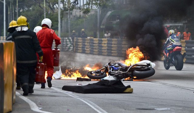 Rider Luis Filipe de Sousa Carreira's motorcycle burns after a crash during qualifying for the Macau Grand Prix, in Macau, November 15, 2012. Carreira died from injuries sustained in the crash. (Photo by Xinhua Cheong Kam Ka/China News Agency)