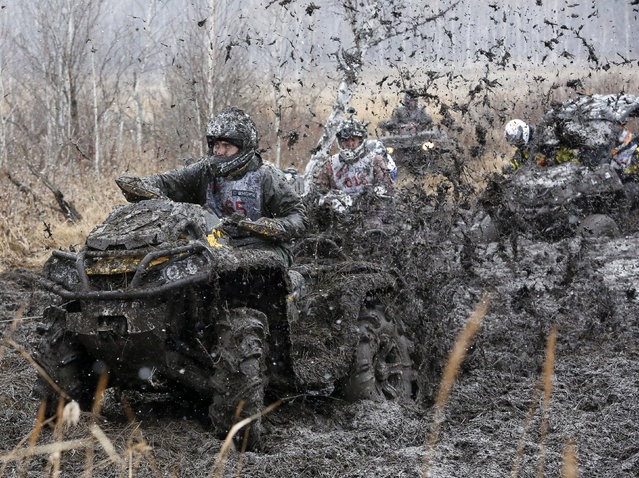 "Riders compete during the ""Kings of the Off-road"" quad bike amateur regional race in a Siberian boggy district near the village of Kozhany, southwest of Krasnoyarsk, October 11, 2014. The race day, which consisted of four extreme tournaments on All Terrain Vehicles (ATV) and Utility Terrain Vehicles (UTV), marked the end of their summer sports season, according to organizers. (Photo by Ilya Naymushin/Reuters)"