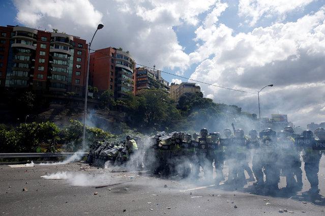 Riot police block the street during a rally to demand a referendum to remove Venezuela's President Nicolas Maduro in Caracas, Venezuela, September 1, 2016. (Photo by Carlos Garcia Rawlins/Reuters)