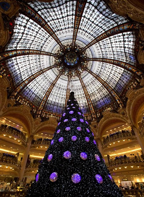 A Christmas tree is seen in the main hall of the Galeries Lafayette department store in Paris, December 18, 2012. (Photo by Michel Euler/Associated Press)