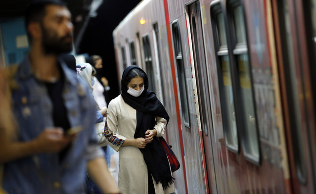 An Iranian woman wearing face mask takes a train in a subway station in Tehran, Iran, 10 June 2020. Media reported that according to the last report by the health ministry the spread of novel coronavirus (Covid-19) is growing up while in past 24 hours 2011 new cases have been diagnosed and 84 people died. Iranian health ministry warned people to don't use subways as much as they can. (Photo by Abedin Taherkenareh/EPA/EFE)