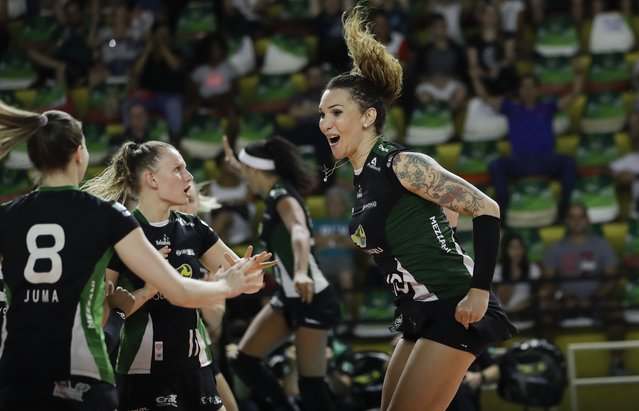 Bauru's volleyball player Tiffany Abreu, right, celebrates with teammates during a Brazilian volleyball league match in Bauru, Brazil, Tuesday, December 19, 2017. Rodrigo Abreu, as he used to be known, played in men's leagues in Brazil, Italy, Spain and Holland before changing gender in 2014. (Photo by Andre Penner/AP Photo)