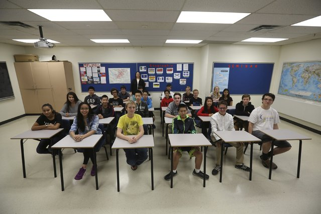 Teacher Kathy Stauch's 9th Grade French-immersion geography class pose for a picture at Lisgar Collegiate Institute in Ottawa, Canada, September 24, 2015. (Photo by Chris Wattie/Reuters)