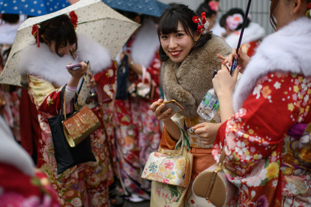 Women wearing kimonos gather after attending a Coming of Age ceremony on January 8, 2018 in Yokohama, Japan. (Photo by Carl Court/Getty Images)