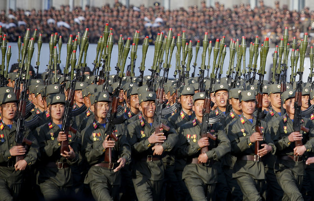 North Korean soldiers in historic uniforms march during a parade on the Kim Il Sung Square, Saturday, October 10, 2015, in Pyongyang, North Korea. (Photo by Wong Maye-E/AP Photo)
