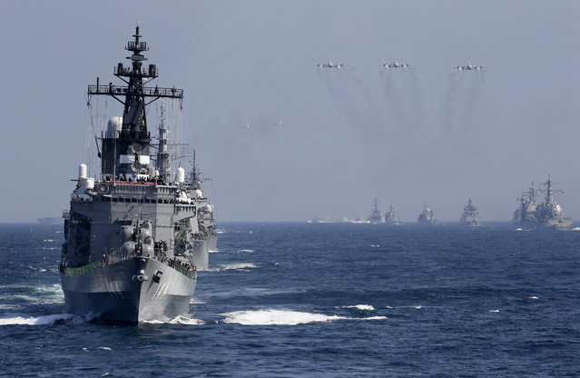 Japanese Maritime Self-Defense Force flagship and destroyer Kurama (L) leads a fleet of navy vessels during a fleet review by Prime Minister Shinzo Abe in Sagami Bay off Odawara, Kanagawa Prefecture, southwest of Tokyo, Japan, 18 October 2015. Sixty-two vessels and 37 aircrafts participated in the review. (Photo by Kimimasa Mayama/EPA)